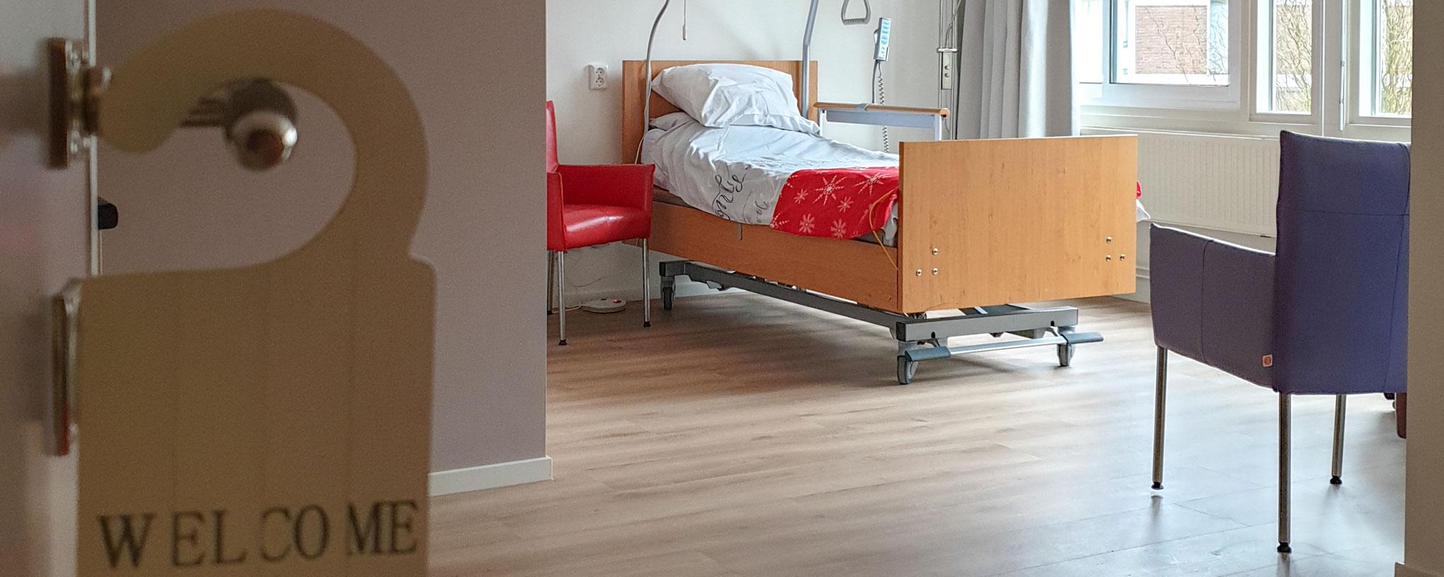 een beeld van een kamer in het Hospice